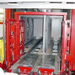 foerdertechnik-palettenundstapelfordertechnik-hubrahmenmitkanalfahrzeugenineinemregalbediengeratfurkanallagertechnik